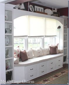 Storage window bench. Love this- would have to figure out how to work around the outlet so I don't lose it though.