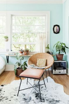 This would just be anothermidcentury-inspired space without that impactful mint wall in the background. It really makes the neutral décor pop too.