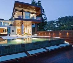 Modern look - emphasis on wooden deck with glass railings