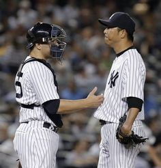 GAME 67: Tuesday, June 19, 2012 - New York Yankees catcher Russell Martin, left, confers with starting pitcher Hiroki Kuroda during the sixth inning of a baseball game against the Atlanta Braves at Yankee Stadium in New York. (AP Photo/Kathy Willens)