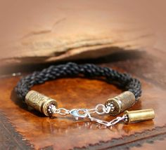 Bullet casing bracelets - unique and creative designs in brass, nickel, crystals! Browse Gun Goddess now for bracelets and more bullet jewelry you'll love! Bullet Shell Jewelry, Shotgun Shell Jewelry, Bullet Casing Jewelry, Ammo Jewelry, Leather Jewelry, Metal Jewelry, Jewelry Crafts, Jewelery, Leather Cord