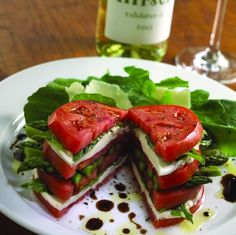 Medium ripe beef steak tomatoes, buffalo mozzarella or large bococcini cheese, crisply steamed asparagus (use a little lime citrus during steaming, half a lime will do) fresh basil, salt & pepper to taste. balsamic vinegar and olive oil.