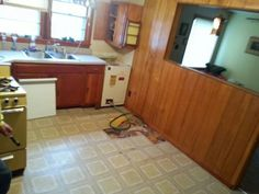 Tearing up kitchen floor and installing new hot water heater.