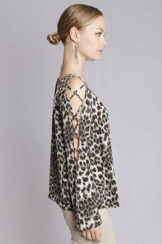 Love the criss cross sleeve!