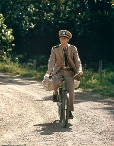 "Ron Howard rides a '40s cruiser in a scene from the 1974 ABC Movie of the Week, ""Locusts,"" in which a swarm of the titular creatures terrifies a Montana farm community. Howard is Danny Fletcher, a Navy pilot, returning home."
