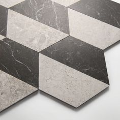 Inspired by the architecture of New York, the new Gramercy Park collection offers a versatile range of marble slab, tiles and décors. It includes contemporary marble tiles in eye-catching geometric patterns alongside plain honed surfaces. Available in a palette of 3 colourways – ivory, soft grey and veined black, the collection is designed as a suite of surfaces to be used in combination or individually. Slab options, ideal for skirtings, architraves, vanities and shower trays also available. Black Marble Tile, Marble Tiles, Brochure Inspiration, Gramercy Park, Natural Stone Flooring, Mediterranean Design, Natural Texture, Mosaic, Geometric Patterns