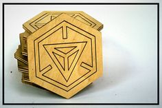 Ingress themed wooden coasters. These laser etched and cut coasters have the Ingress Hex logo. Other ingress themed images are available, as well
