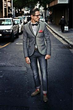 Shop this look on Lookastic:  http://lookastic.com/men/looks/pocket-square-and-bow-tie-and-belt-and-dress-shirt-and-jeans-and-oxford-shoes-and-blazer/1429  — Red Polka Dot Pocket Square  — Black Bow-tie  — Brown Leather Belt  — Grey Dress Shirt  — Navy Jeans  — Brown Leather Oxford Shoes  — Grey Blazer