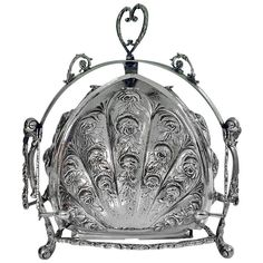 Rare Continental Silver Folding Biscuit Box circa 1890 The box opening to reveal triple lobe sectional `blossom' compartment, rococo inspired repoussé motif of roses and scrolls. Marked with crescent, moon,800 (silver) for Germany C.1890, Makers Mark J.V.H. Weight: 55 oz. Measures: 10 x 7.5 inches.