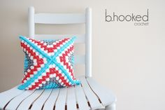 Granny Square Pillow - love the colours in this and the clever use of a huge crochet granny square to wrap a cushion