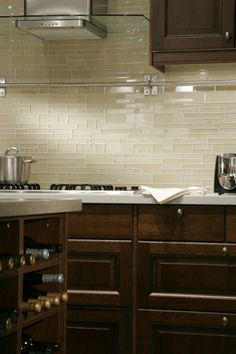 Love the clear glass tile backsplash in this kitchen www.OakvilleRealEstateOnline.com