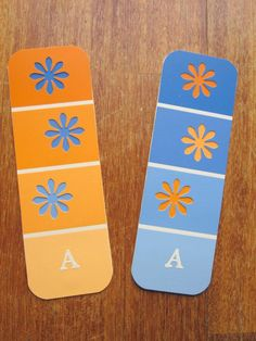 Bookmark idea: layer paint chips with contrasting punches. Add a ribbon or an initial to punch it up a little.