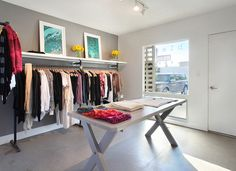 This photo is of a boutique, but how marvelous would it be to have a dressing room like this, too?