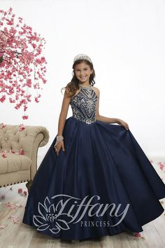 Tiffany Princess 13528 is a sleeveless high neck girl's pageant dress with an intricately beaded bodice, beaded criss-cross back straps with lace-up, and a floor length A-line satin skirt. Pagent Dresses For Kids, Pageant Dresses For Women, Little Girl Pageant Dresses, Pageant Gowns, Girls Dresses, Little Girl Gowns, Pageant Hair, Pretty Dresses For Kids, Little Girls Fancy Dresses