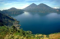 View of de Atitlan Lake n caldera from a paragliding launch spot. Volcanic activity began in de Lake Atitlan area abaht 11-12 million yrs ago. De present-day stratovolcanoes n caldera represent de most recent of four periods of volcano growth n caldera collapse. This recent period of activity began abaht 1.8 million yrs ago. A large explosive eruption abaht 84,000 yrs ago formed de most recent Atitlan caldera. Lake Atitlan fills part of de caldera. panajachel, Solola_ South Guatemala