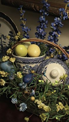 upstairs downstairs: Easter Basket and Blue Willow  nice way to use odd dishes + old saucers in arrangements