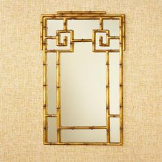 """Gold Bamboo Mirror Gold bamboo in a Zen like Chippendale pattern with a hint of Greek key has a global success! 38""""Hx23.5""""Wx1""""D"""
