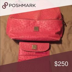 Dooney &Bourke ostrich pink with matching wallet Matching purse and wallet authentic, purse has 2 front zipper pockets and one inside with key clip, wallet has lots of card space and checkbook holder Dooney & Bourke Bags Shoulder Bags