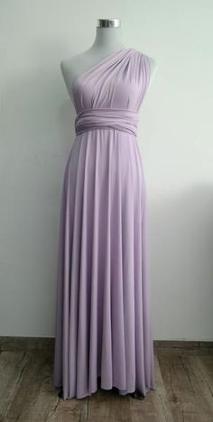 """Questions? Call us Monday - Friday 6pm - 10pm CST at 1(312) 212-3724 LilZoo Knee Length Convertible Infinity MultiWay Wrap Dress in Lavender This Listing Includes: One Full Length ( 42"""" from band ) Convertible Dress in Lilac Purple One Bandeau tube top in Lavender Purple FAQ: Q: How many Ways can this dress be worn? A: Dozens! The options are endless, the styles are changed by simply twisting and tying the dress straps. You can view some of the most popular styles, along with how t..."""