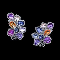 MulticolorSapphireEarrings Hues of pinks and purples are gathered in this bouquet of multi-colored sapphires in a complementary arrangement.