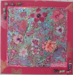 """""""Second-Hand Rose"""" Art quilt by Jeanne Turner McBrayer on shiny Textiva background. Outer border is made from an embroidered linen skirt from Goodwill.  Lots of embellishments."""