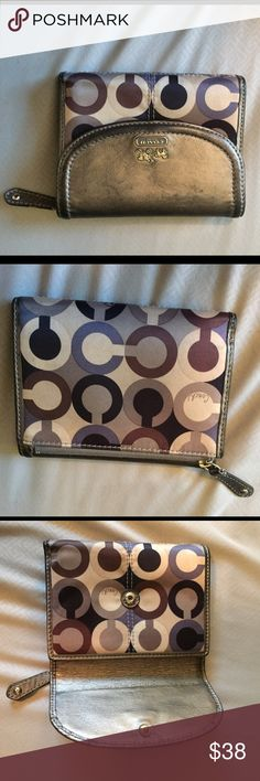 Coach wallet 100.% authentic coach wallet. It has card pockets and id picture spot all visible in picture. It has a zipper pocket on outside for change. Coach Bags Wallets