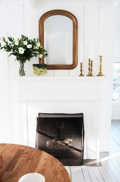 Sweet little fireplace.A Country Farmhouse: Guest House: After Photos White Fireplace, Diy Fireplace, Fireplace Design, Fireplaces, Simple Fireplace, White Mantle, Fireplace Decorations, Mantle Ideas, Minimalist Fireplace