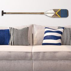 Handmade, this beautiful Stratton Home Decor Nautical Oar Wall Decor will enhance the style of your home. Made of MDF, this stunning wall art is sure to add flair and elegance to your home. This white