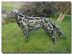 I never would have thought to use old horse shoes to create a dog sculpture, but that is exactly what Tom Hill did.    Pretty amazing, don't you think?