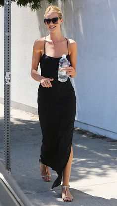 Rosie Huntington-Whiteley in a casual black maxi dress with nude t-strap sandals