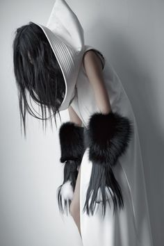 This is Avant-Garde fashion because of the haunting look of the gloves and hair