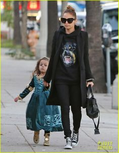 Nicole Richie wearing Balenciaga City Bag In Black House of Harlow 1960 Chelsea Sunglasses in Black What Goes Around Comes Around Studded Converse sneakers Givenchy Rottweiler Print Hoodie