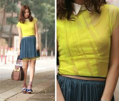 LOVE the peek of yellow under her skirt. Reminder: you can layer dresses with skirts.