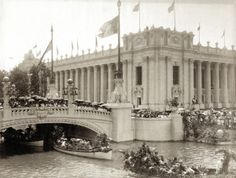 Water parade on Transportation Day at the 1904 World's Fair entering the Grand Basin at northeast corner of Palace of Education. Lead boat includes David R. Francis. Missouri History Museum