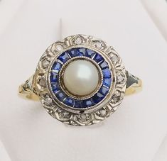 Catawiki pagina online de subastas Art Deco ring in 18 kt bicoloured gold with a an Akoya pearl, calibrated sapphires and diamonds