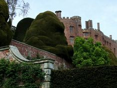 A medieval castle, fortress and grand country mansion, Powis is an example of a military stronghold which was preserved and renewed by continual occupation. Welsh Castles, Castles In Wales, Castles In England, Most Haunted Places, Wales Uk, Medieval Castle, Monument Valley, Britain, Places To Go