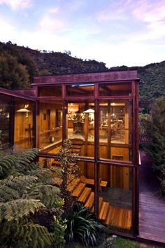 "The ""Waterfall Bay House"" is a spectacular wooden residence designed by Pete Bossley Architects and located in New Zealand."