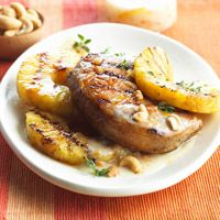 Grilled pork and pineapple. This super fast dinner is ready in 18 minutes. The grilled chops are livened up with a sweet and slightly tart sauce of yogurt and orange marmalade.