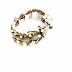 J. Crew Jeweled Stretch Bracelet Very good pre loved condition. The elastic is a little stretched out, but not so much that it is going to snap. See third picture. Lots of life left. First picture filtered. No trades or PayPal please don't ask. J. Crew Jewelry Bracelets