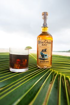 Pirate Flag is a refreshing two ingredient cocktail recipe that will take you less than 5 minutes to make. In a rocks glass fill with ice, pour Blue Chair Bay® Spiced Rum followed by cola. Stir, sit back and feel like a pirate. #bluechairbay #spicedrum #BCBHappyHour Rum Cocktail Recipes, Cocktails, Barbary Coast, Spiced Rum, Mixer, Vodka Bottle, Pirates, Spices, Rocks
