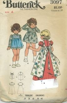 An undated Butterick Pattern 3097.  High-waisted dress gathered into fitted bodice has round neckline, sleeve variations, and purchased ruffled eyelet trim.  Pinafore gathered into high waistline has square neckline and attached back self tie sash.