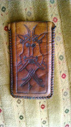 A leather phone holder with Viking motive.. Handmade by Paweł Wodziński