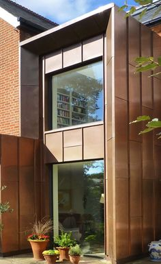Bronze metal cladding is a great material on this house extension Zinc Cladding, Cladding Design, Exterior Wall Cladding, Brick Cladding, External Cladding, Cladding Panels, House Cladding, Facade Design, Facade House