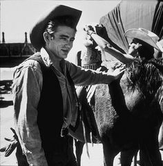 GIANT (1955) - James Dean on location near Marfa, Texas - Based on the novel by Edna Ferber - Produced & Directed by George Stevens - Warner Bros. - Publicity Still.