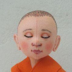 novice monk tibet by helenpriem, via Flickr  Beautiful doll!
