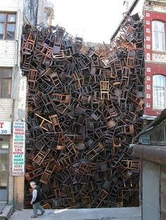 "Doris Salcedo, ""Chairs,"" 1550 chairs, creates a tension between the two adjoining buildings."