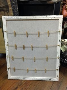 White distressed clothespin message board. Call (540) 381-1137 to purchase.