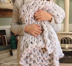 Materials: 6 Skeins of Premier Yarns Mega Tweed in the color White Tweed Your arms as the needles That's it! Time: 1 hour if you know how to arm…