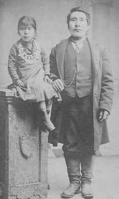 c.1910? Coquille Indian tribe-historical photo Lily Ned and Charlie Ned, in Oregon. Girl wearing a necklace, with her father.
