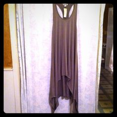 Dress Gray, polyester and spandex dress. High/low with longer sides. Very stretchy. The Hanger Dresses